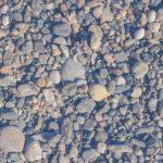 Beach stones surface. Marine mineral beauty harmony. Sea pebble texture.