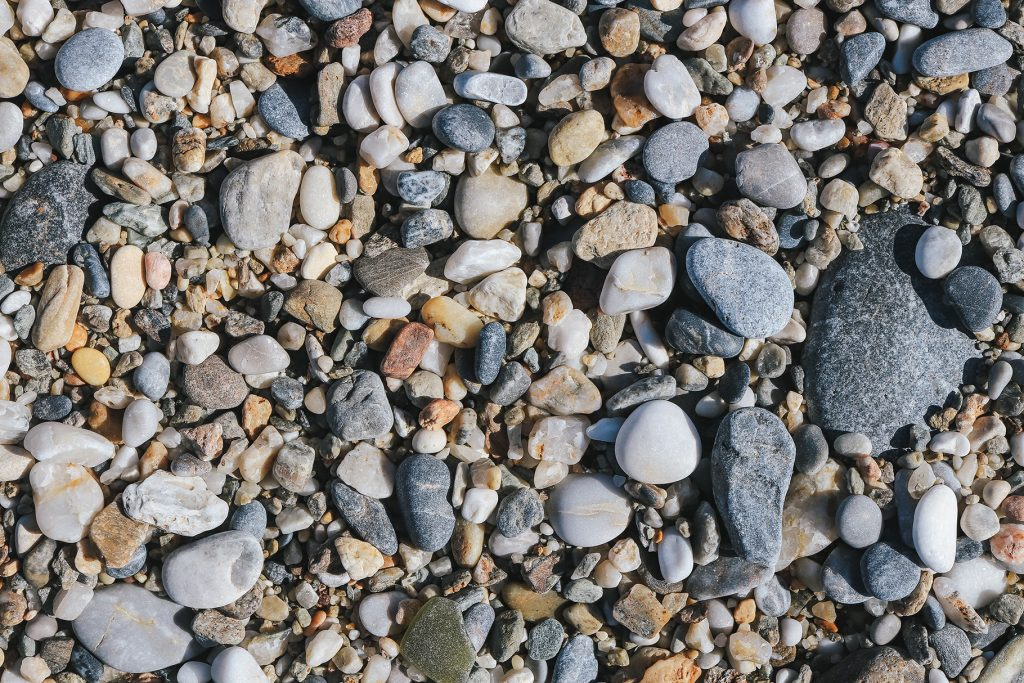 Marine mineral beauty harmony. Beach stones surface. Sea pebble texture.