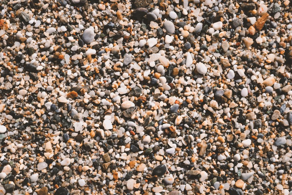 Beach stones surface. Sea pebble texture. Marine mineral beauty harmony.