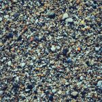 Marine mineral beauty harmony. Sea little pebble texture. Beach stones surface.