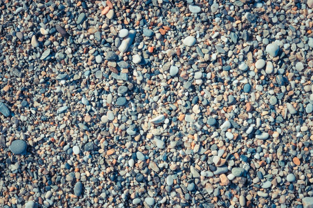 Beach stones surface. Marine mineral beauty harmony. Sea pebble texture.