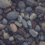 Marine mineral beauty harmony. Beach stones surface.