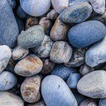 Marine mineral beauty harmony. Sea pebble cobblestones texture. Beach stones surface.