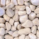 Marine mineral harmony beauty. White sea pebble cobblestones texture. Beach stones surface.