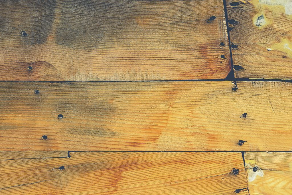 Wood planks shipboard texture. Wooden ship board with nails and screws background.