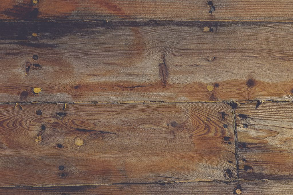 Planks shipboard texture. Wooden ship board with nails and screws background.