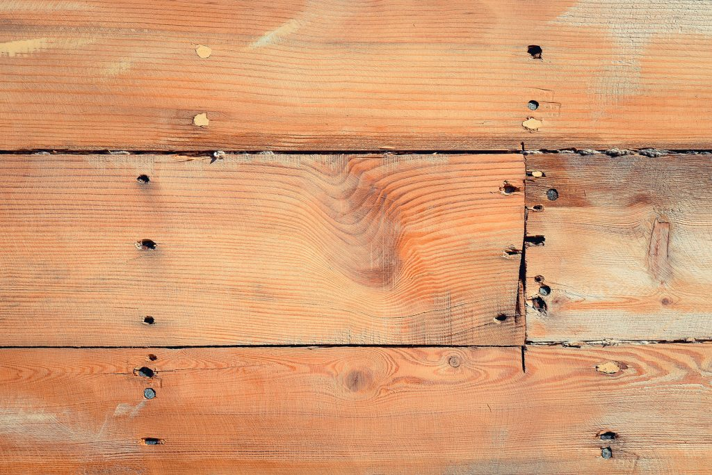 Wooden ship board with nails and screws background. Wood planks shipboard texture.