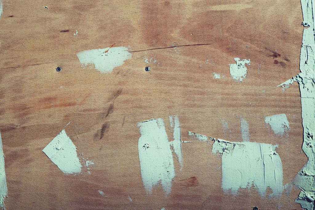 Wooded shipboard epoxy resin repairing texture. Plywood ship board with nails and screws background.