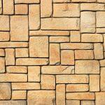 Masonry stone cladding wall texture. Geometric shapes surface background.