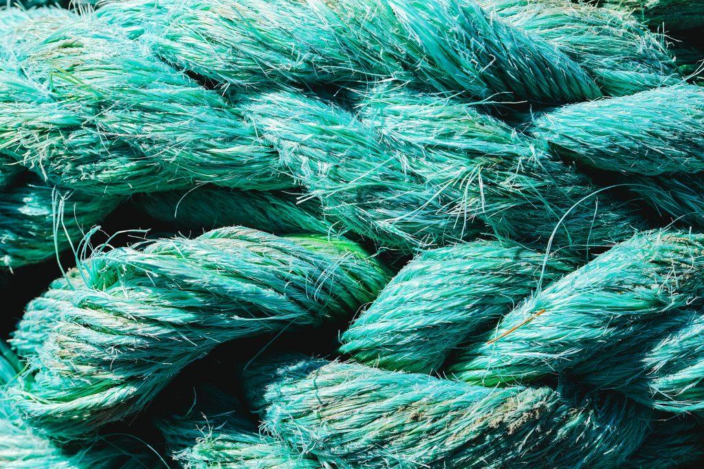 Big fat blue mooring rope texture. Nautical marine background.