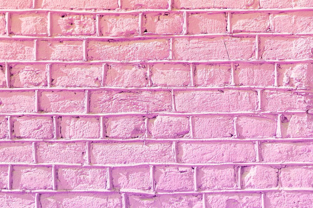 Lilac bricks wall texture. Concrete blocks wall background.