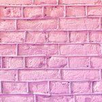 Lilac bricks wall texture. Concrete blocks wall background.