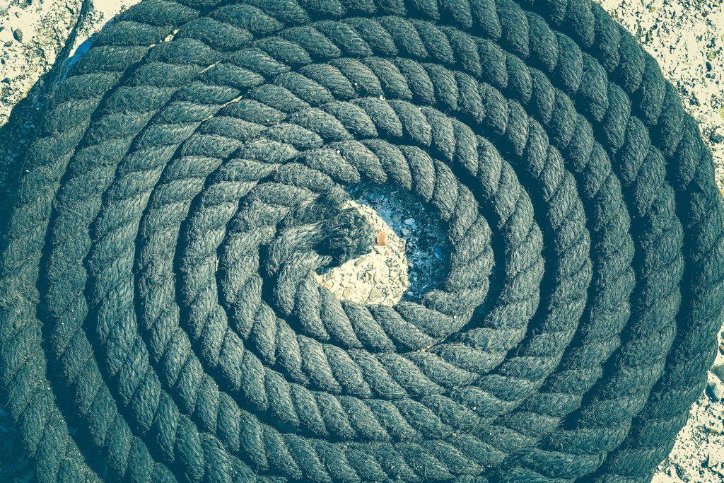 Twisted black sea rope. Nautical marine background.