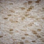 Different stone tiles background. Rocky cliff tile wall texture.