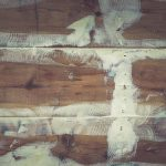 Repaired wooden ship board background. Wood planks epoxy resin repairing shipboard texture.