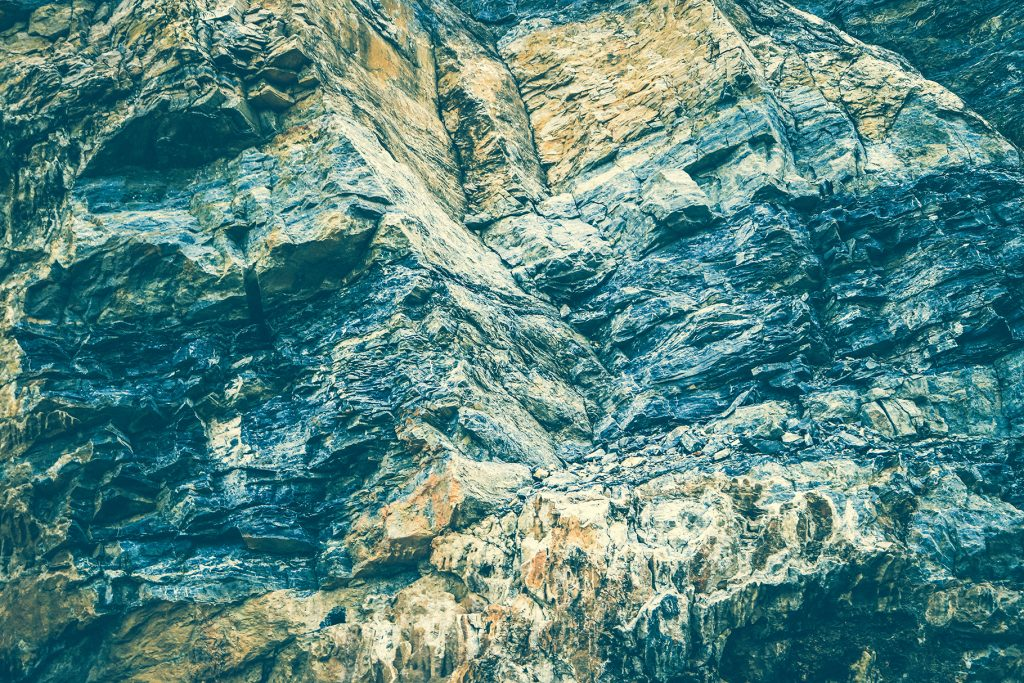 Laminate rock texture. Mountain pattern background.