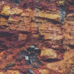 Rustic layered rock texture. Mountain pattern background.