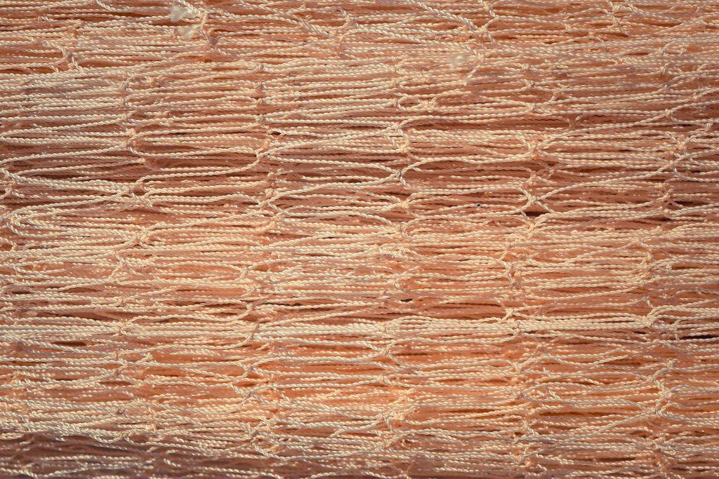 Nylon fishnet texture. Fishnet macro background.