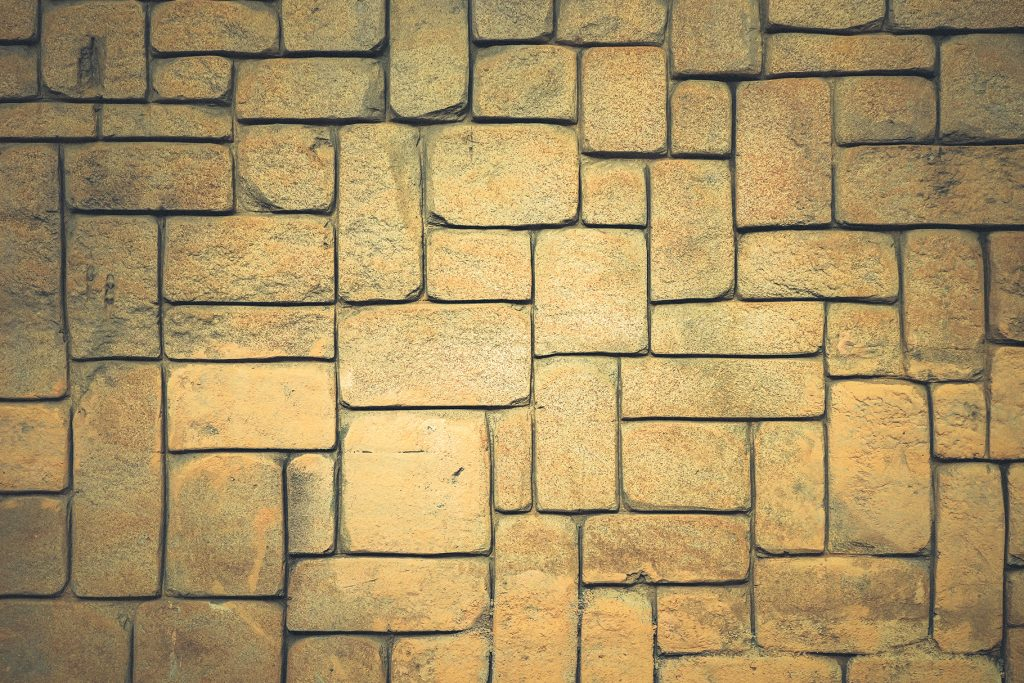 Geometric shapes surface background. Masonry stone cladding wall texture.