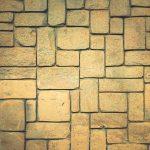 Geometric shapes surface background. Masonry stone cladding wall texture.