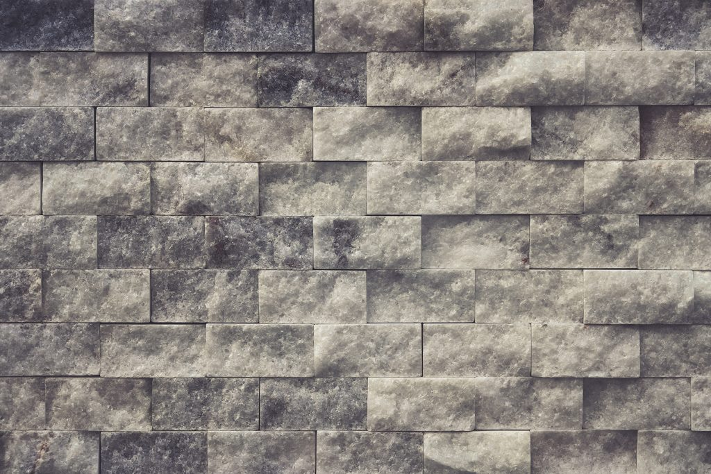 White stone interior background. Alabaster masonry cladding tiles wall texture.