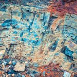 Layered rock with a rustic parts texture. Mountain pattern background.