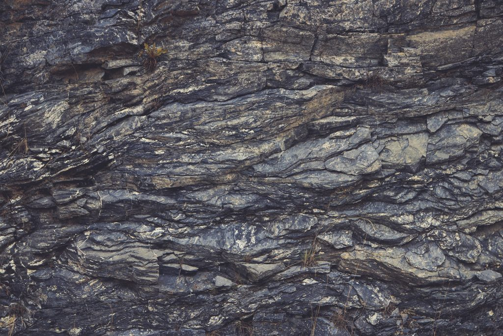 Rough rock texture. Mountain pattern background.
