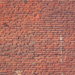 Red bricks wall texture. Concrete blocks wall background.
