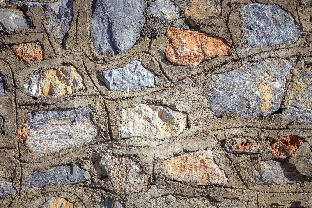 Cobblestones wall with concrete texture