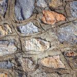 Cobblestones wall with concrete texture
