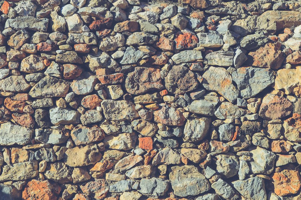Cobblestones wall texture. Stones surface background.