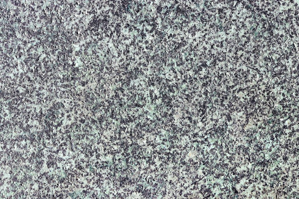 Granite surface background. Blue granite wall texture.