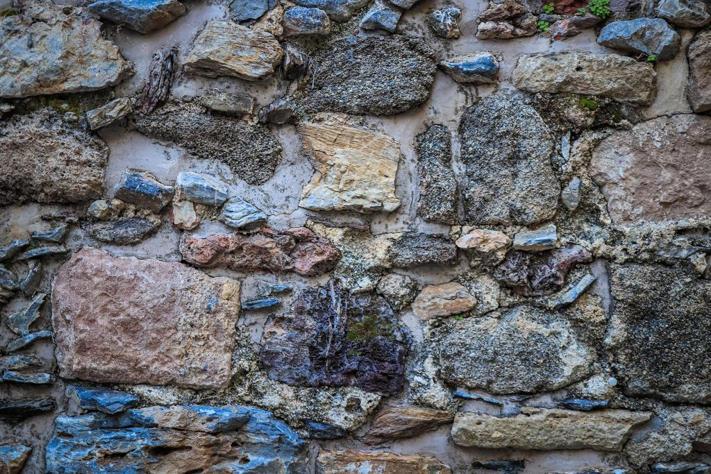 Stones wall texture. Rocky cliff stones surface background.