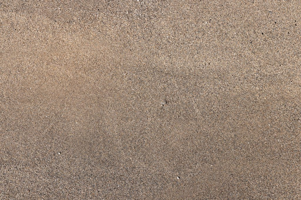 Sea Beach Sand Texture. Outdoor sand background. Sandy Surface Backdrop.