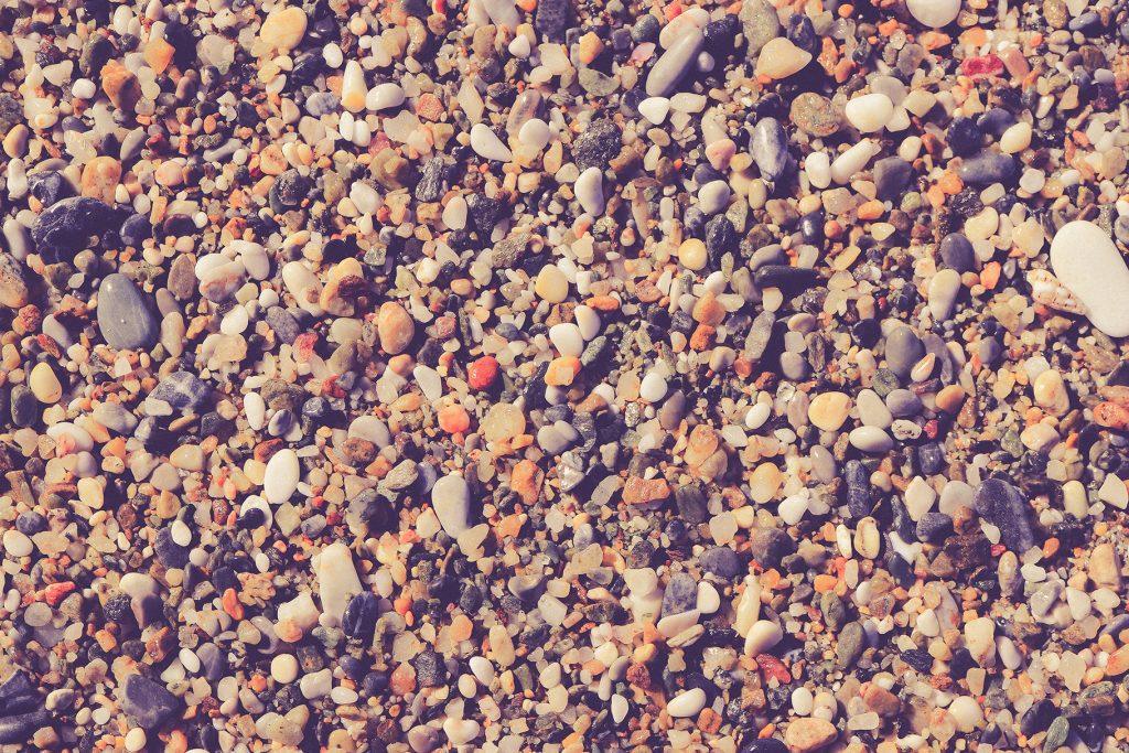 Marine mineral beauty harmony. Beach stones surface. Sea pebble texture.