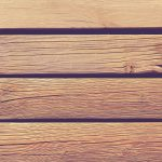 Wood planks with screws and nails texture. Wooden beach way. Wooden boards background. Horizontal direction.